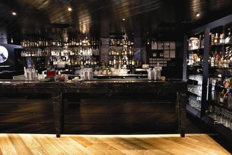 Galley Room's luxurious dark marble bar
